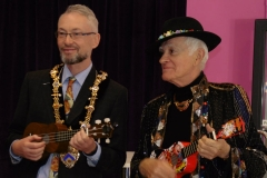 Stratford Mayor John Bicknell and local poet Don Barber try their hands at playing the ukulele